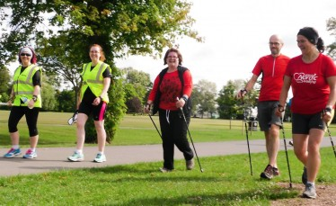 Nordic walkers participating in parkrun